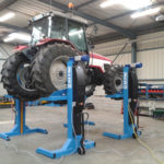 Tractor lifted by SEFAC mobile column lifts